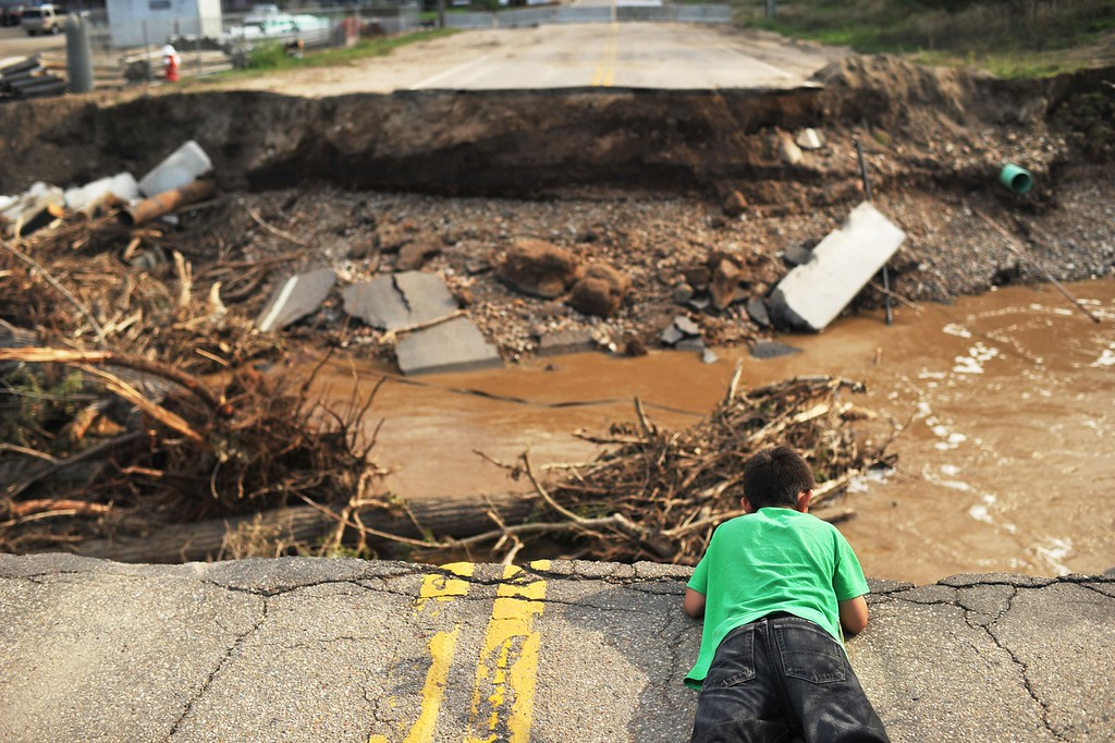 . LONGMONT, CO - September 21 : Dominic Deleon, 11, of Longmont is checking the bridge damaged by flood water from St. Vraian Creek from Sunset St. Longmont, Colorado. September 21, 2013. (Photo by Hyoung Chang/The Denver Post)