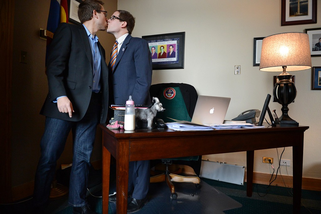 . DENVER, CO. - MARCH 12: House Speaker Mark Ferrandino, D-Denver,, right, says goodbye to his partner, Greg Wertsch following the vote on Senate Bill 11 at the Colorado House of Representatives in Denver, CO March 12, 2013. Senate Bill 11 is sponsored by Ferrndino of Denver and Rep. Sue Schafer of Wheat Ridge, two gay Denver Democrats. The Bill passed and will allow gay couples to form civil unions in Colorado. (Photo By Craig F. Walker/The Denver Post)