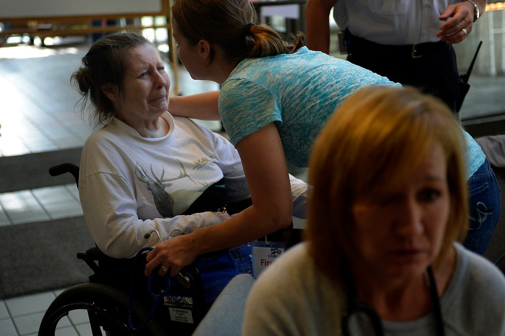 . LONGMONT, CO. - September 13: Susan Elston is overwhelmed after being rescued from Lyons during a fisit ti the aid station at the LifeBridge Christian Church in Longmont September 13, 2013 Longmont, Colorado. (Photo By Joe Amon/The Denver Post)