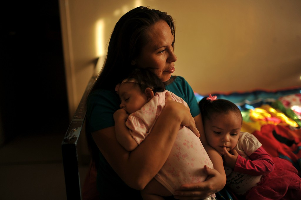. DENVER, CO. NOVEMBER 14 : Olivia Velasquez, 34, center, and her children Destiny Casillas, age 2, right, and Genesis Casillas, four month old, have been Salvation Army Lambuth Family Center for 3 months. Denver, Colorado. November 14, 2013. Velasquez is homeless and to try and get back on her feet. (Photo by Hyoung Chang/The Denver Post)