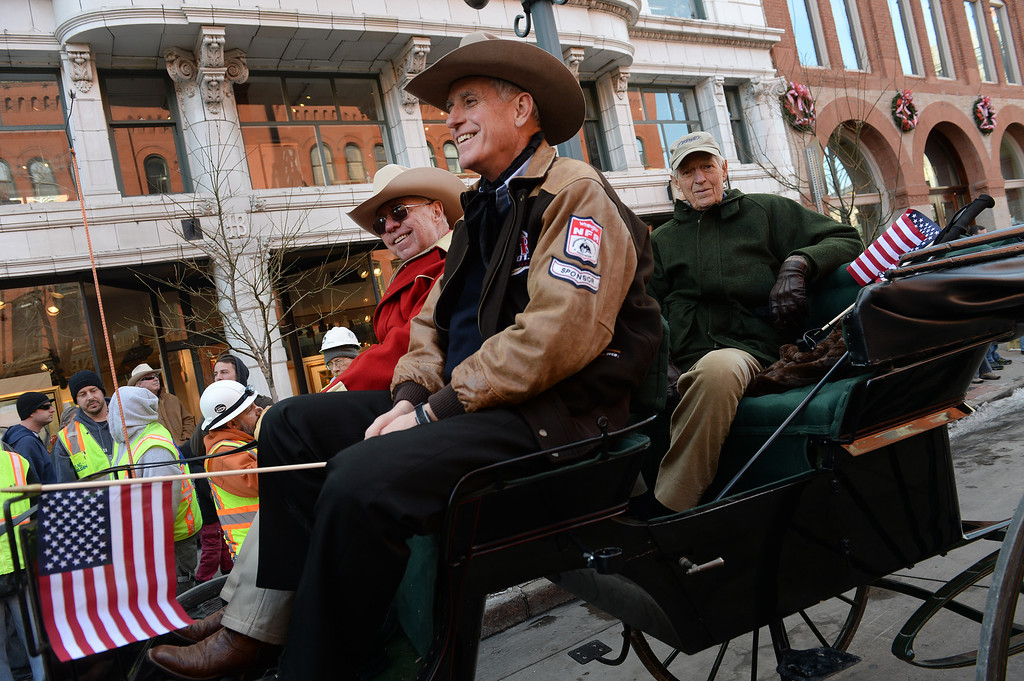 . DENVER, CO - JANUARY 9, 2014:  Pete Coors, in center, gets ready to help lead the National Western Stock Show Parade with 2014 Citizen of the West honoree Fred Hamilton, in the back at right and Glen Keller, left, president of the Westernaires, along 17th street  in Denver, Co on January 9, 2014.  The National Western Stock Show Kick-Off Parade featured Longhorn cattle herded through the streets of downtown Denver, along with bands, horses, floats, cowboys and rodeo queens. The parade started at noon at Union Station in Lower downtown Denver and headed up 17th street.   The annual National Western Stock Show runs Jan. 11-26. Schedules and ticket information is available at NationalWestern.com.  (Photo By Helen H. Richardson/ The Denver Post)
