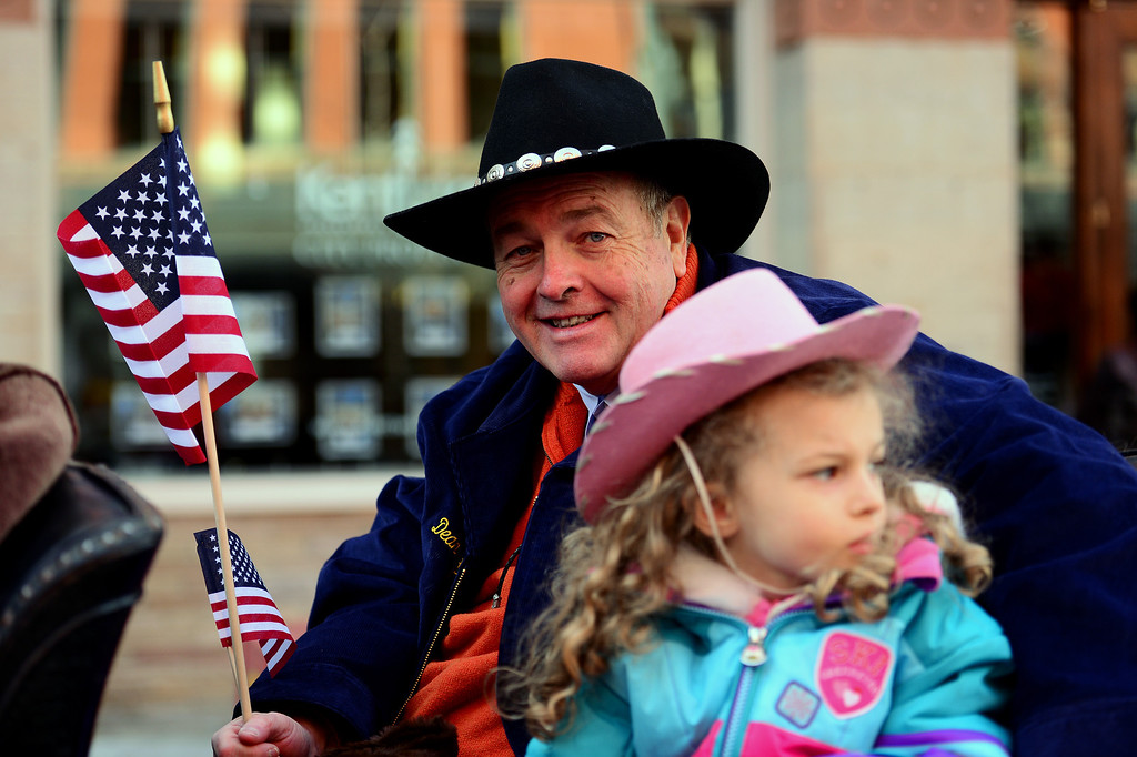 . DENVER, CO - JANUARY 9, 2014: Dean Singleton, former publisher of the Denver Post, sits with his granddaughter Kaiya Singleton, 4, before the start of the National Western Stock Show Parade along 17th street  in Denver, Co on January 9, 2014. Singleton was this year\'s marshall.  The National Western Stock Show Kick-Off Parade featured Longhorn cattle herded through the streets of downtown Denver, along with bands, horses, floats, cowboys and rodeo queens. The parade started at noon at Union Station in Lower downtown Denver and headed up 17th street.   The annual National Western Stock Show runs Jan. 11-26. Schedules and ticket information is available at NationalWestern.com.  (Photo By Helen H. Richardson/ The Denver Post)