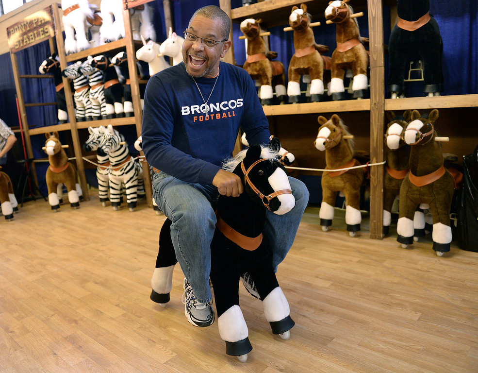 . DENVER, CO. - JANUARY 15: Robert MacCary got a kick out of the Pony Pal exhibit inside the Stadium on the National Western Stock Show grounds Wednesday afternoon, January 15, 2014. The stuffed toys scoot across the floor with wheels on their hooves and are sold in a variety of sizes. Photo By Karl Gehring/The Denver Post