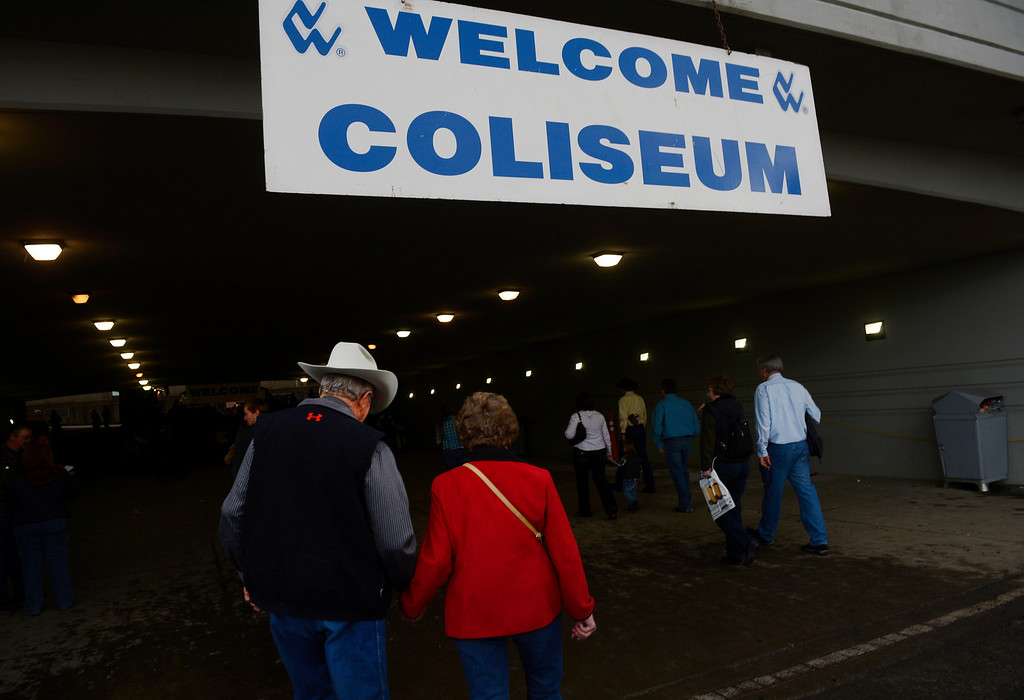 . DENVER, CO. - JANUARY 11:  Folks head to the Denver Coliseum on opening day of the National Western Stock Show Saturday, January 10, 2014. (Photo By Andy Cross / The Denver Post)