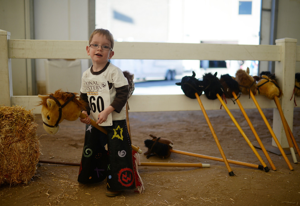 . DENVER, CO. JANUARY 25: Andrey Klamm, 4, is warming up for the stick horse rodeo at Ames Activity Pavilion at the National Western Stock Show in Denver, Colorado January 25, 2014. Twenty-eight children competed in the event. (Photo by Hyoung Chang/The Denver Post)