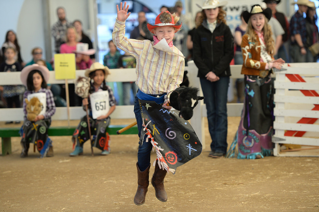 . DENVER, CO. JANUARY 25: Leiana Butchart, 8, is competes in the stick horse rodeo at Ames Activity Pavilion at the National Western Stock Show in Denver, Colorado January 25, 2014. Twenty-eight children competed in the event. (Photo by Hyoung Chang/The Denver Post)
