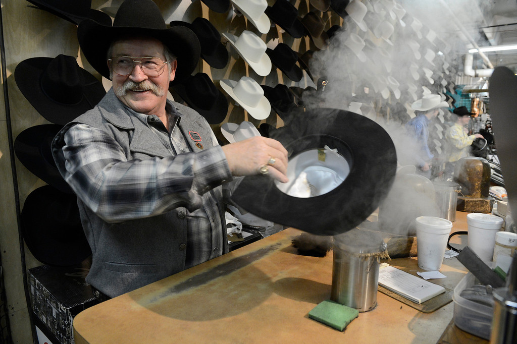 . DENVER, CO. - JANUARY 11:  Rick Bishop, steams and cleans a cowboy hat on opening day of the National Western Stock Show Saturday, January 10, 2014. Bishop owns Western Tradition hat company and has had a booth at the NWSS for 34 years. (Photo By Andy Cross / The Denver Post)