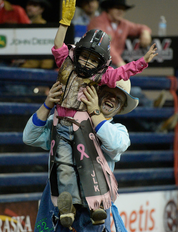 . DENVER, CO. - JANUARY 11:  Jordan Kane, 5, gets hoisted by a rodeo clown after riding a miniature bull during the Colorado Vs The World Rodeo on opening day of the National Western Stock Show Saturday, January 10, 2014. (Photo By Andy Cross / The Denver Post)