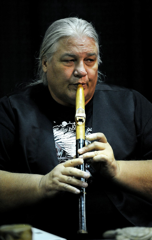. Mark Barfoot plays one of his handmade flutes on Jan. 19 during the Colorado Indian Market at the Denver Mart in Denver, Colo. Photo by Jamie Cotten, Special to The Denver Post