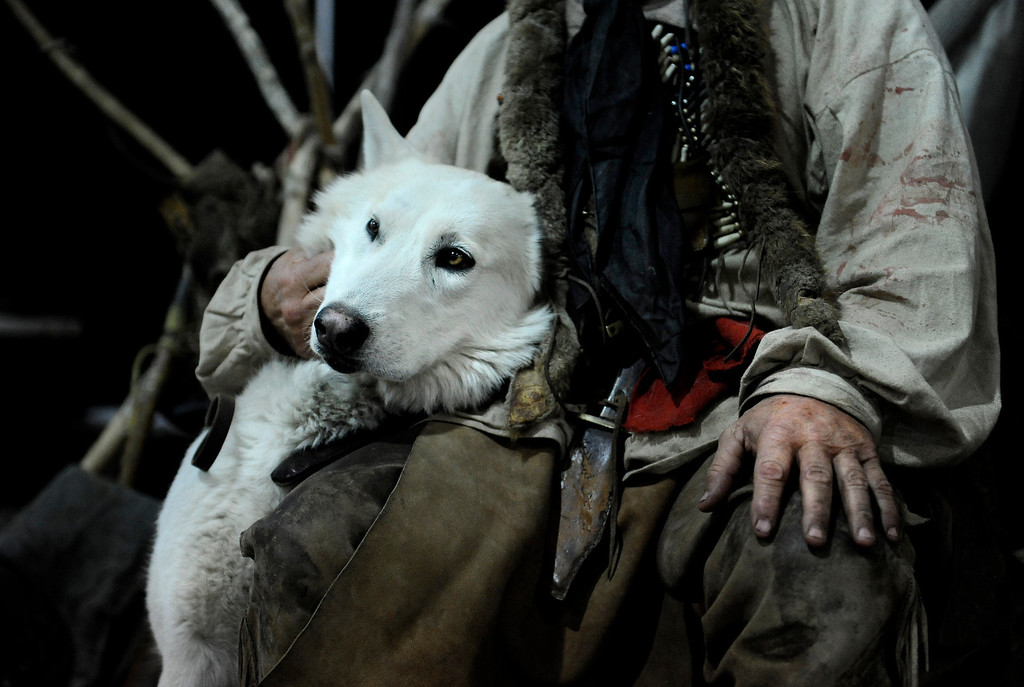 . Kevin Browning holds his timber wolf, Little Brother, during the Colorado Indian Market on Jan. 19 at the Denver Mart in Denver, Colo. Photo by Jamie Cotten, Special to The Denver Post