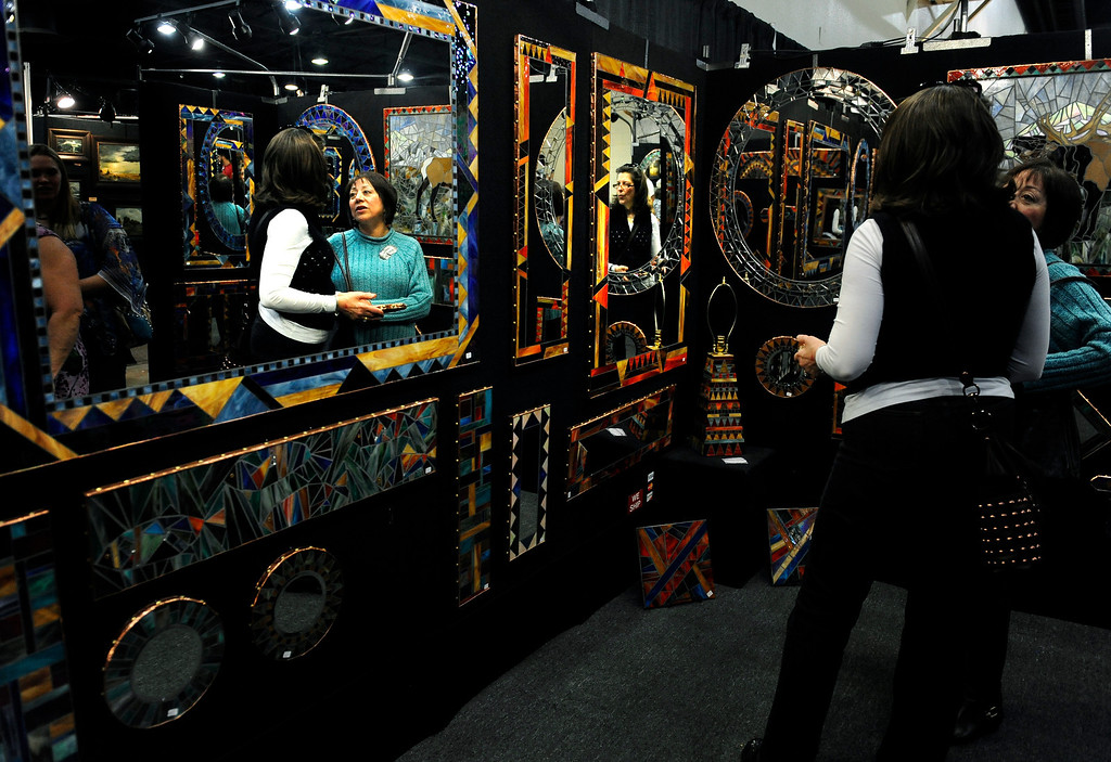 . People wander through the Colorado Indian Market at the Denver Mart on Jan. 19 looking at Native American artwork in Denver, Colo. Photo by Jamie Cotten, Special to The Denver Post