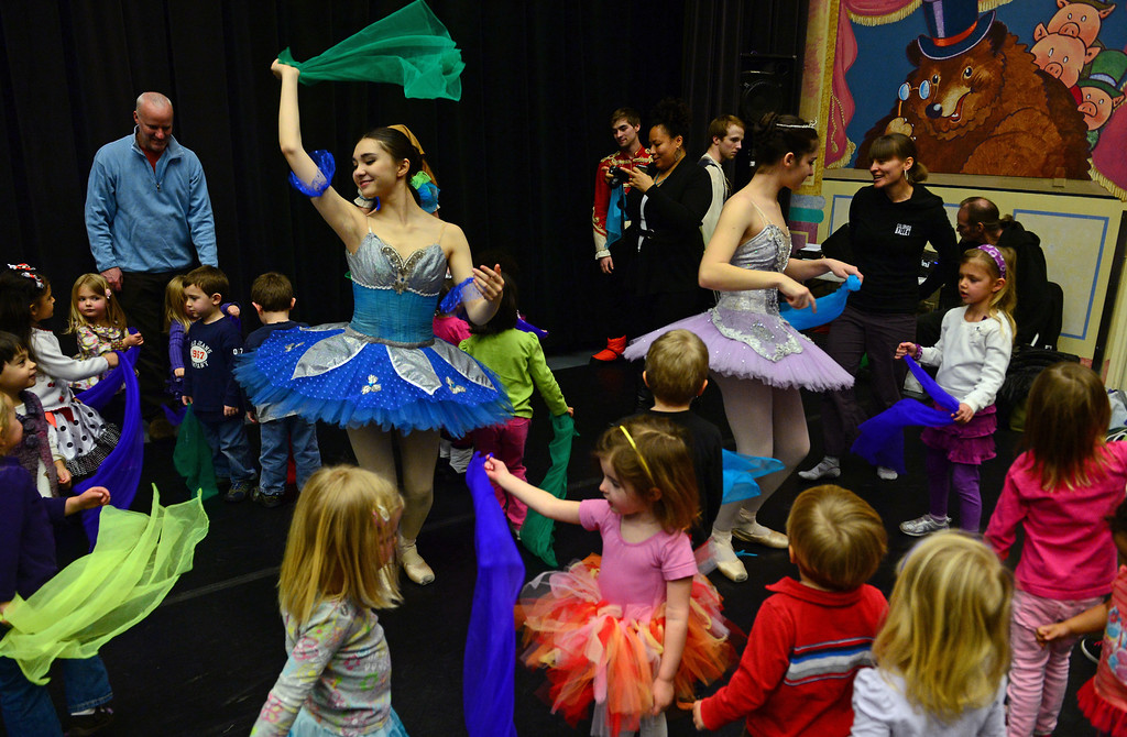 """. DENVER, CO - FEBRUARY 9,  2014:  Ballet dancers Ryan Lee, in blue, left, and Emma Daddario, in purple, right, use scarves with the young children to teach them how to move to music after their performances at the Children\'s Museum in Denver,  CO on February 9, 2014. Colorado Ballet hosts \""""From the Page to the Stage\"""" performances at schools, hospitals, museums and libraries.  During these performances, Colorado Ballet Studio Company dancers perform excerpts from ballets based on Shakespeare and the classics such as the upcoming production of Cinderella.  The outreach program makes more than 60,000 contacts each year.   (Photo By Helen H. Richardson/ The Denver Post)"""