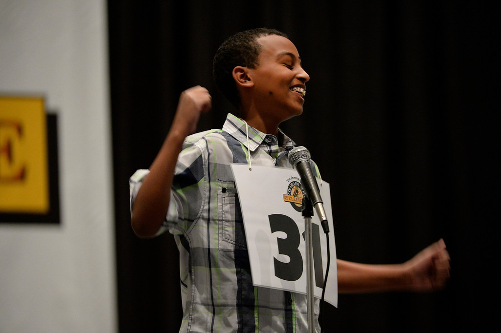 . DENVER, CO. - MARCH 08: Spelling bee contestant, Aaron Abai, 8th grader at Collegiate Academy of Colorado, rejoices after spelling a word correctly in the late rounds of the 74TH Annual Colorado State Spelling Bee Saturday, March 08, 2014 at the Colorado Convention Center.  (Photo By Andy Cross / The Denver Post)