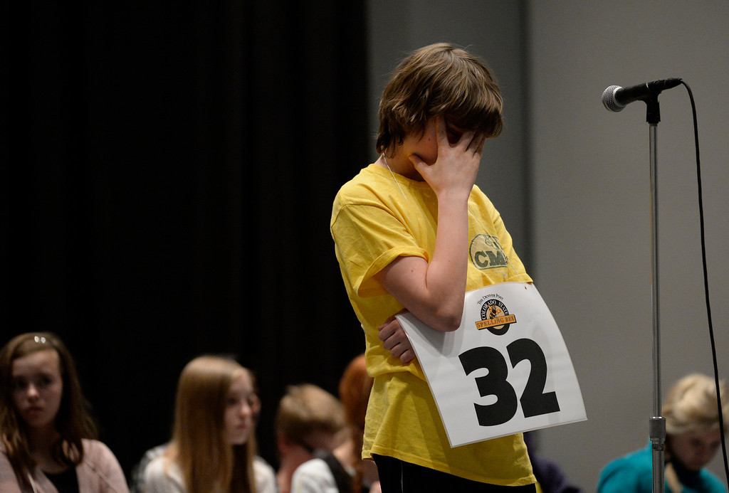 . DENVER, CO. - MARCH 08: Abe Lamontagne, an eight grader at Creighton Middle School, focuses before attempting to spell a word during the 74TH Annual ColoradoState Spelling Bee Saturday, March 08, 2014 at the Colorado Convention Center. (Photo By Andy Cross / The Denver Post)