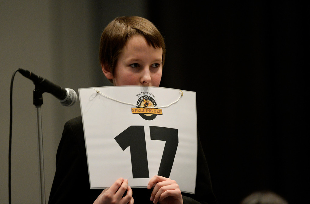 . DENVER, CO. - MARCH 08: Eric Webb, an 8th grader at Hamilton Middle School, takes his time getting information on a word during the 74TH Annual Colorado State Spelling Bee Saturday, March 08, 2014 at the Colorado Convention Center. (Photo By Andy Cross / The Denver Post)