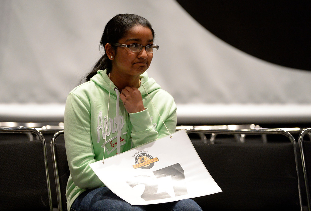 . DENVER, CO. - MARCH 08: Spelling bee contestant, Roshini Narayanan, 8th grader from the Ridgeview Classical School, cracks a half smile during back and forth rounds with eventual winner, Alex Jurich, Hamilton Middle School during the 74TH Annual Colorado State Spelling Bee Saturday, March 08, 2014 at the Colorado Convention Center. Narayanan placed second. (Photo By Andy Cross / The Denver Post)