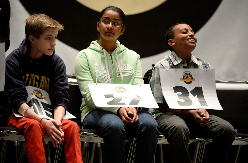 . DENVER, CO. - MARCH 08: Spelling bee contestants, from left to right, Alex Jurich, Roshini Narayanan, Ridgeview Classical School, and Aaron Abai, 8th grader at Collegiate Academy of Colorado, sit in their chairs during  late rounds of the 74TH Annual Colorado State Spelling Bee Saturday, March 08, 2014 at the Colorado Convention Center. Abai was smiling because he had just spelled a word correctly, Jurich eventually won and Narayanan placed second. (Photo By Andy Cross / The Denver Post)