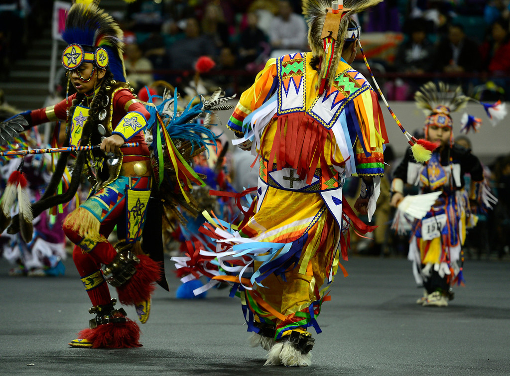 . DENVER, CO - MARCH 22: Participants move out in to the arena for the Junior Boys Grass competition. The Denver March Pow Wow takes place at the Denver Coliseum as a number of American Indian tribes participate in dance competitions and host arts and crafts sales, fry-bread concessions, as well as storytelling and demonstrations. The event continues through Sunday with a grand entry parade at 11 a.m. (Kathryn Scott Osler The Denver Post)