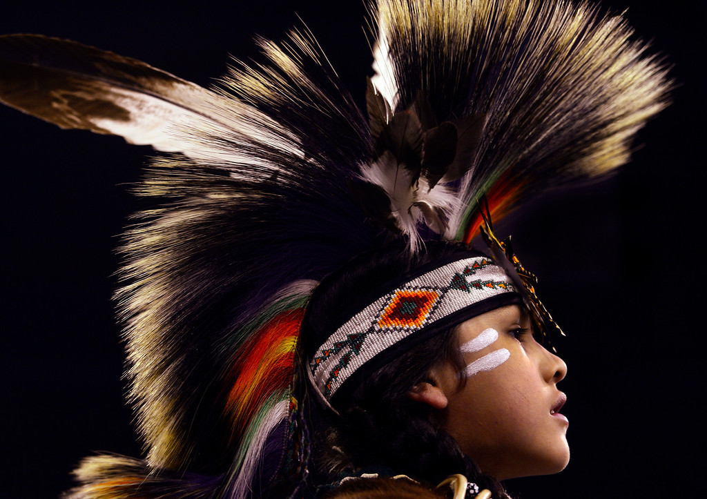. DENVER, CO - MARCH 22: Yamni White Hat from Rosebud, South Dakota, pauses for a rest during the Junior Boys Traditional competition. The Denver March Pow Wow takes place at the Denver Coliseum as a number of American Indian tribes participate in dance competitions and host arts and crafts sales, fry-bread concessions, as well as storytelling and demonstrations. The event continues through Sunday with a grand entry parade at 11 a.m. (Kathryn Scott Osler The Denver Post)