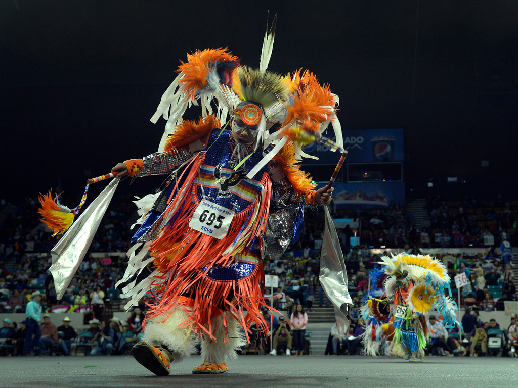 . DENVER, CO - MARCH 22: Participants move out in to the arena for the Junior Boys Fancy competition. The Denver March Pow Wow takes place at the Denver Coliseum as a number of American Indian tribes participate in dance competitions and host arts and crafts sales, fry-bread concessions, as well as storytelling and demonstrations. The event continues through Sunday with a grand entry parade at 11 a.m. (Kathryn Scott Osler The Denver Post)