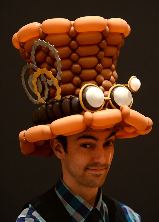 . Balloon artist Rob Balchunas shows off his balloon hat design during  the International World Balloon Convention in Denver, Co on March 30, 2014.  Photo By Helen H. Richardson/ The Denver Post)