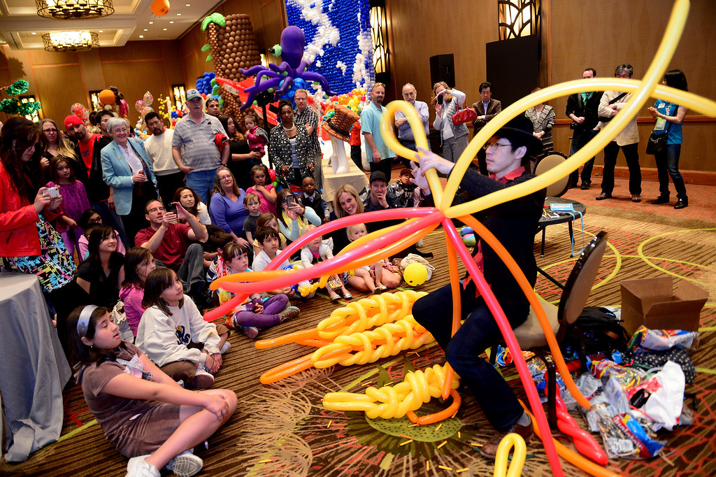 . Takehiro Kai, of Japan, creates a balloon design during the final day of the international World Balloon Convention which had it\'s last day with the showing of the festival of balloons inside the ballroom at The Sheraton in downtown Denver on March 30, 2014.  Photo By Helen H. Richardson/ The Denver Post)