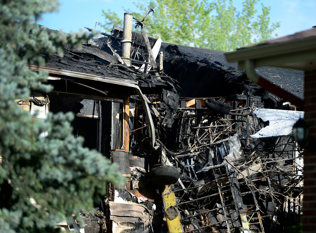 . Emergency crews respond to a home in Northglenn after small plane crashed in to it on Monday, May 5, 2014. (Kathryn Scott Osler, The Denver Post)