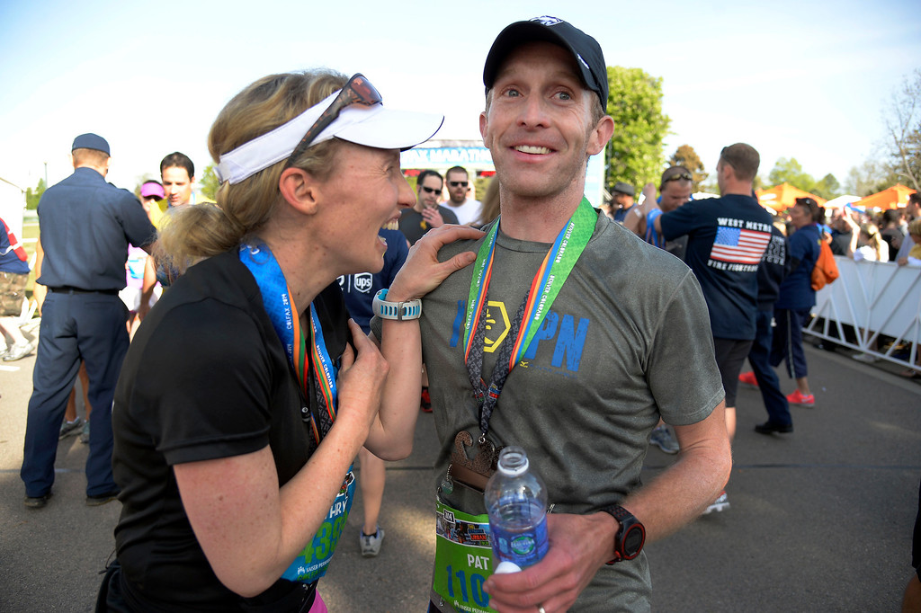 . Kathryn Harter 3 mos. pregnant, congratulates her brother Pat Sullivan who captured the Full Marathon men\'s division in the 9th annual Colfax Marathon May 18, 2014. The 26.2 mile Marathon runs through Denver�s iconic landmark Mile High Stadium (twice), Sloan�s Lake, City Park, Colfax Avenue through Lakewood and Aurora. The Marathon started and finished in City Park where runners enjoyed the rest of the day listening to music by Chris Daniels and the Kings. (Photo by John Leyba/The Denver Post)