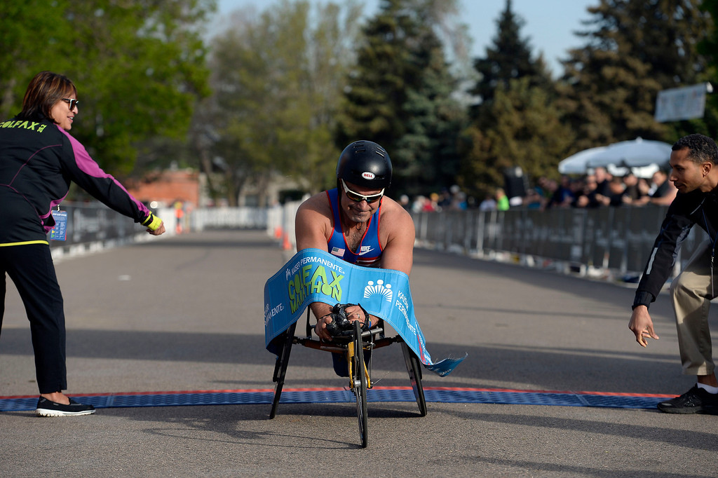 . Brad Ray wins the wheelchair division int he 1/2 marathon at the 9th annual Colfax Marathon May 18, 2014. The 26.2 mile Marathon runs through Denver�s iconic landmark Mile High Stadium (twice), Sloan�s Lake, City Park, Colfax Avenue through Lakewood and Aurora. The Marathon started and finished in City Park where runners enjoyed the rest of the day listening to music by Chris Daniels and the Kings. (Photo by John Leyba/The Denver Post)