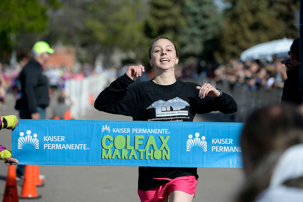 . Alysha De-Laurell crosses the finish line in the women\'s division of the Colfax Marathon with a time of 2:58:40 of the 9th annual Colfax Marathon May 18, 2014. The 26.2 mile Marathon runs through Denver�s iconic landmark Mile High Stadium (twice), Sloan�s Lake, City Park, Colfax Avenue through Lakewood and Aurora. The Marathon started and finished in City Park where runners enjoyed the rest of the day listening to music by Chris Daniels and the Kings. (Photo by John Leyba/The Denver Post)