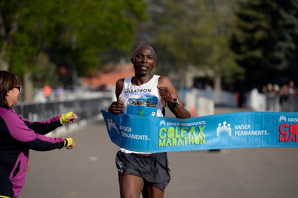 . Geofrey Terer wins the men\'s 1/2 marathon with a a time of 1:08:36 during the 9th annual Colfax Marathon May 18, 2014. The 26.2 mile Marathon runs through Denver�s iconic landmark Mile High Stadium (twice), Sloan�s Lake, City Park, Colfax Avenue through Lakewood and Aurora. The Marathon started and finished in City Park where runners enjoyed the rest of the day listening to music by Chris Daniels and the Kings. (Photo by John Leyba/The Denver Post)