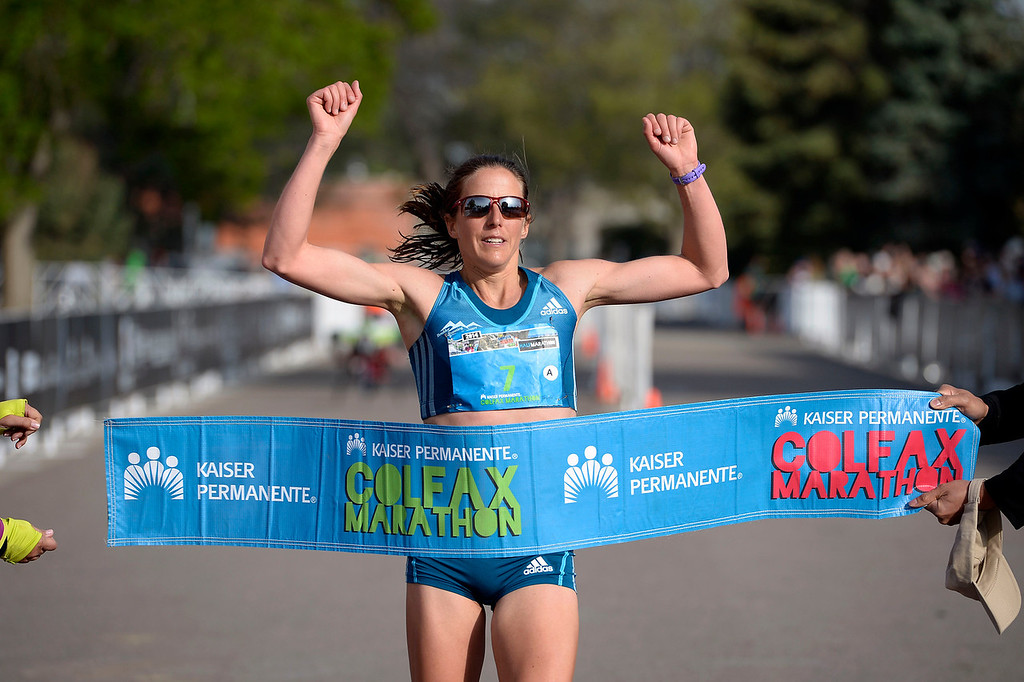 . Brianne Nelson wins the women\'s 1/2 marathon with a time of 1:16:07 during the 9th annual Colfax Marathon May 18, 2014. The 26.2 mile Marathon runs through Denver�s iconic landmark Mile High Stadium (twice), Sloan�s Lake, City Park, Colfax Avenue through Lakewood and Aurora. The Marathon started and finished in City Park where runners enjoyed the rest of the day listening to music by Chris Daniels and the Kings. (Photo by John Leyba/The Denver Post)