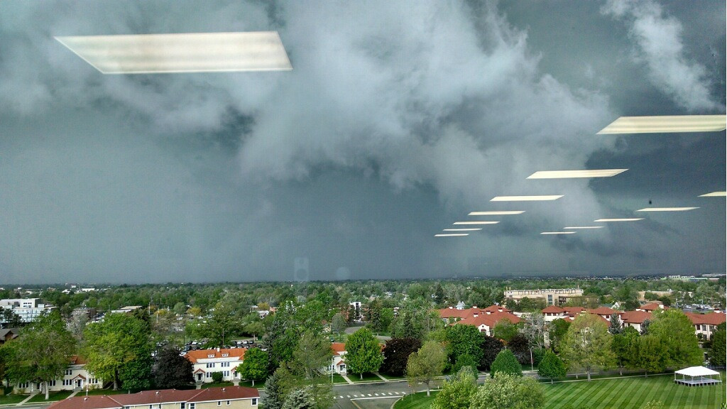 . A funnel cloud is seen out a window at the University of Colorado Hospital, Anschutz Campus during the afternoon of May 21, 2014. (Photo courtesy of Michael Biesecker)