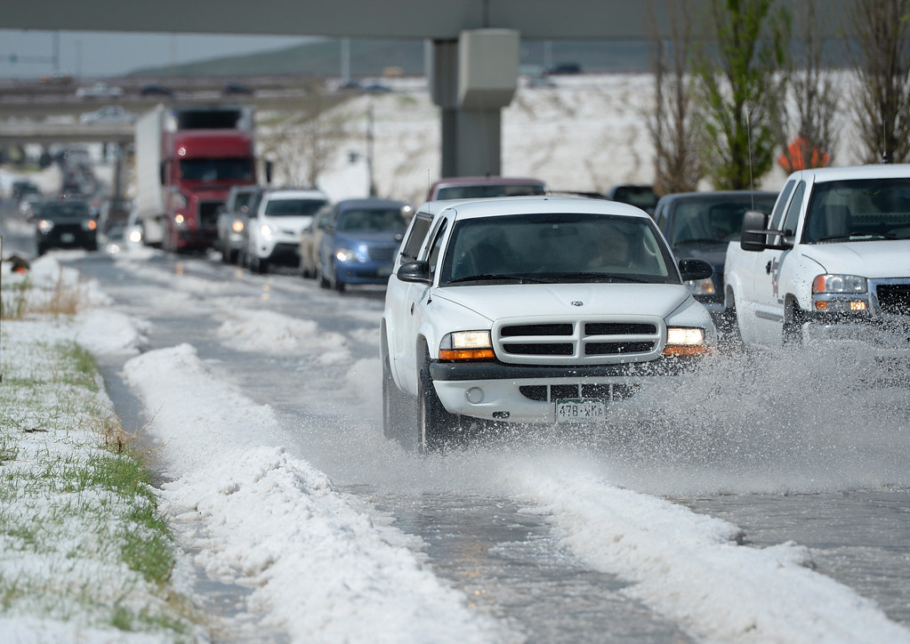 . DENVER, CO - MAY 21: Motorist on Tower Road just south of Pena Boulevard had to contend with hail piled more than a foot high that stranded several vehicles following a storm Wednesday afternoon, May 21, 2014.  (Photo by Karl Gehring/The Denver Post)