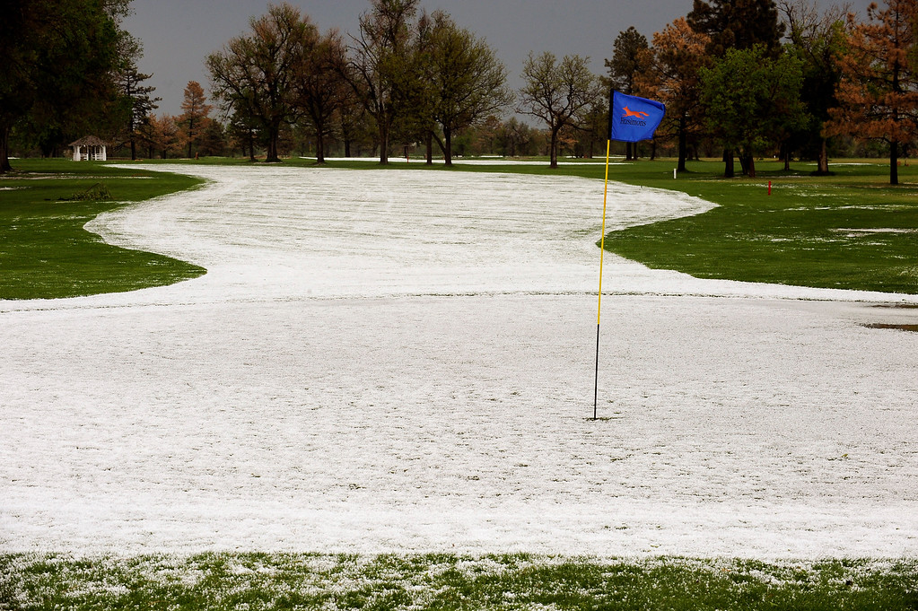 . AURORA, CO. - MAY 21: Hail piled up on the greens and Fairways of Fitzsimmon golf course Wednesday afternoon (Photo by Steve Nehf, The Denver Post)