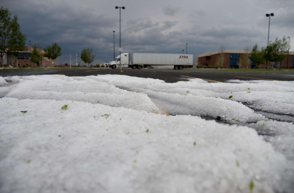 . DENVER MAY 21: A parking lot at Quebec Square is covered in hail from an afternoon storm. Denver, Colorado, May 21, 2014. (Photo by Hyoung Chang/The Denver Post)