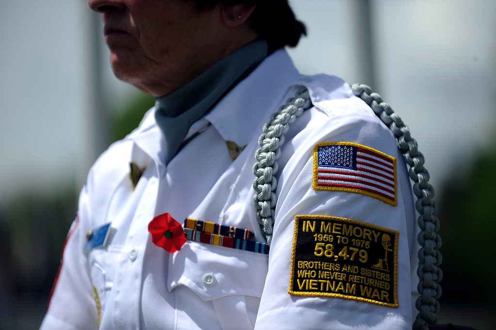 . A Memorial Day ceremony at Fort Logan Cemetery in Denver, Colorado on May 26, 2014. (Photo by Seth McConnell/The Denver Post)