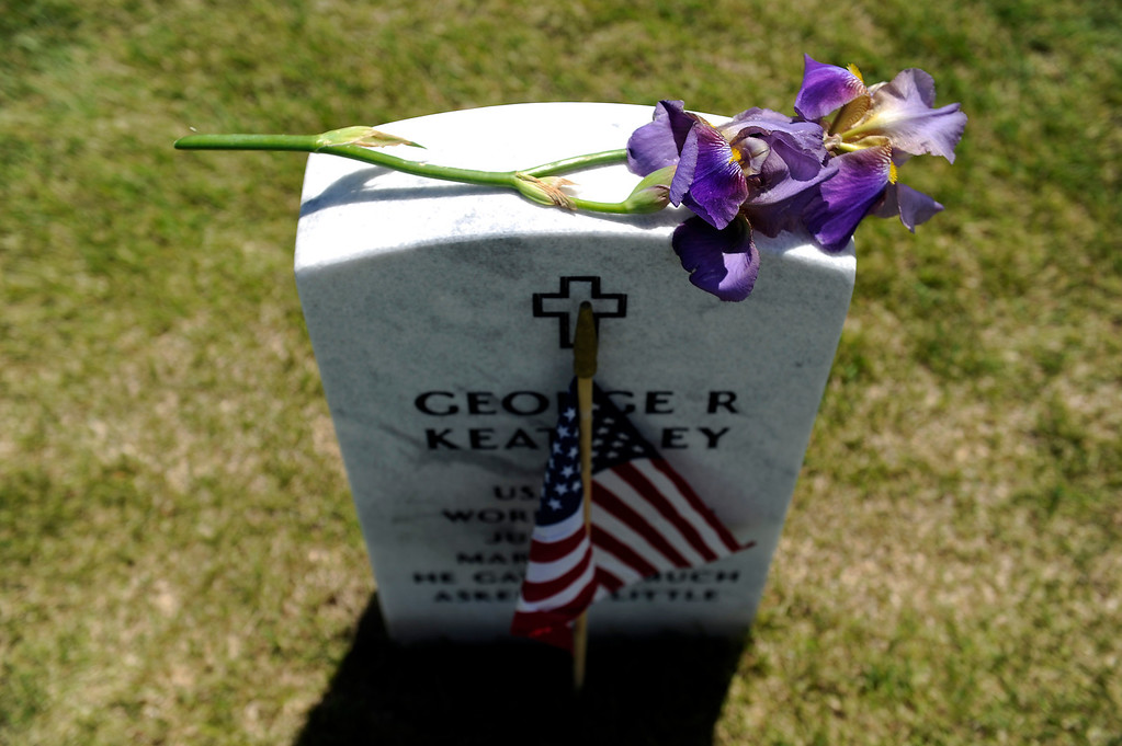 . A flower sits on a headstone during a Memorial Day ceremony at Fort Logan Cemetery in Denver, Colorado on May 26, 2014. (Photo by Seth McConnell/The Denver Post)