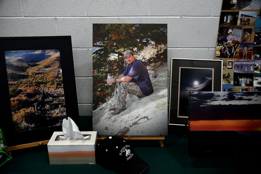 . Photos of Wes Hawkins during the memorial service for him and the other two men who went missing in the Mesa County mudslide. Hundreds of community members gathered for the memorial service at Plateau Valley High School on Sunday, June 01, 2014. (Photo by AAron Ontiveroz/The Denver Post)