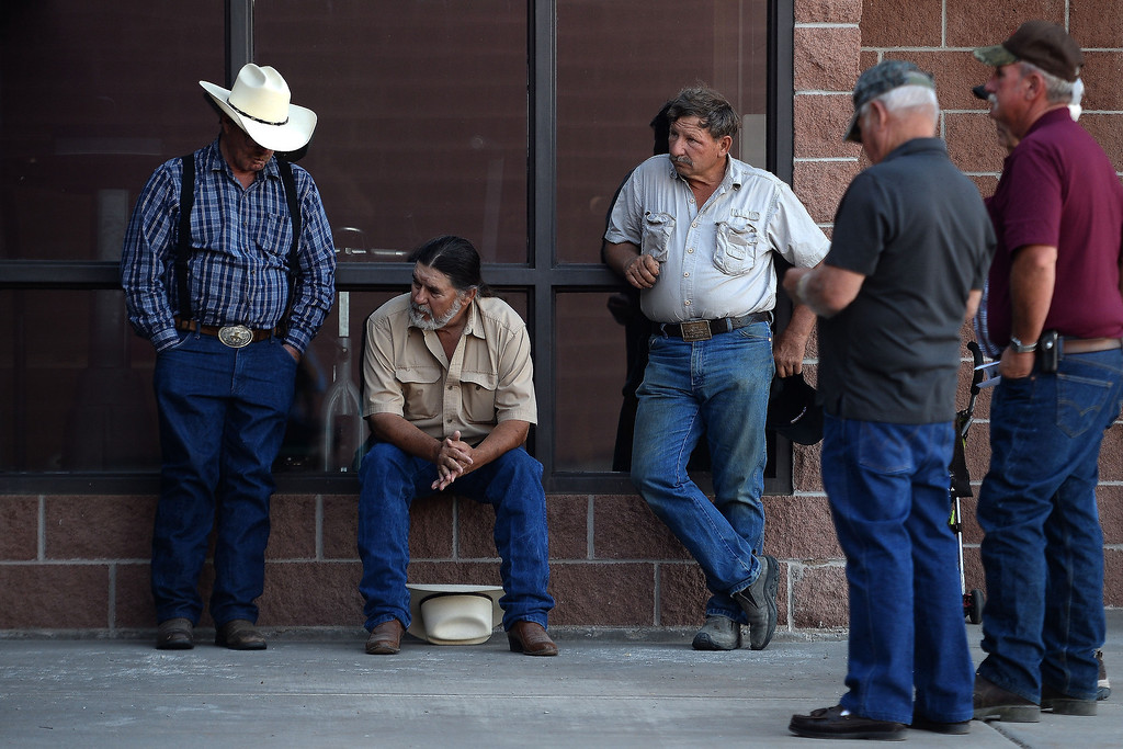 . (from left) Douglas Dean, Pete Mathes and Wesely Reeves reflect outside of the gymnasium during the memorial service for the three men who went missing in the Mesa County mudslide. Hundreds of community members gathered for the memorial service at Plateau Valley High School on Sunday, June 01, 2014. (Photo by AAron Ontiveroz/The Denver Post)