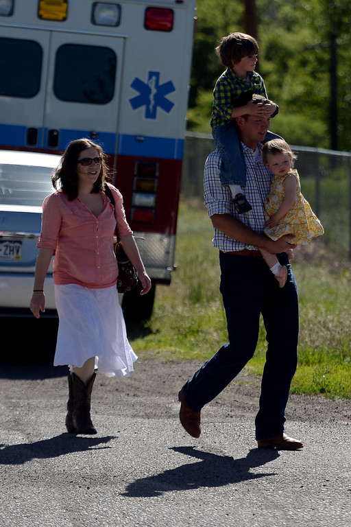 . Attendees arrive in droves before the memorial service for the three men who went missing in the Mesa County mudslide. Hundreds of community members gathered for the memorial service at Plateau Valley High School on Sunday, June 01, 2014. (Photo by AAron Ontiveroz/The Denver Post)