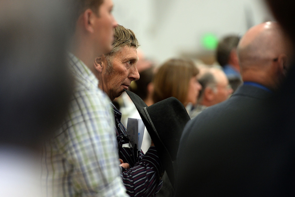 . A community member listens to a speaker during the memorial service for the three men who went missing in the Mesa County mudslide. Hundreds of community members gathered for the memorial service at Plateau Valley High School on Sunday, June 01, 2014. (Photo by AAron Ontiveroz/The Denver Post)