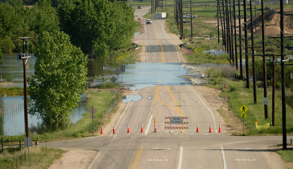 . Several roads along the Poudre River in northwest Greeley are closed due to flood waters, June 2, 2014. A flood warning for the Poudre River near Greeley has been extended through Sunday. (Photo by RJ Sangosti/The Denver Post)