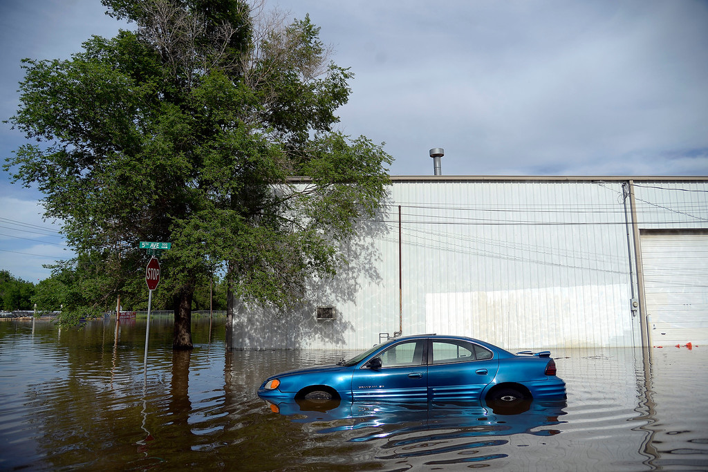 . A Pontiac Grand AM is soaked on Fifth Avenue after an area of town flooded. A heavy rain caused parts of Greeley to flood on Monday, June 2, 2014. (Photo by AAron Ontiveroz/The Denver Post)