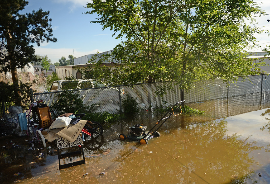 . Flood water continues to rise along the Poudre River in Greeley, June 3, 2014. A flood warning for the Poudre River near Greeley has been extended through Sunday. (Photo by RJ Sangosti/The Denver Post)