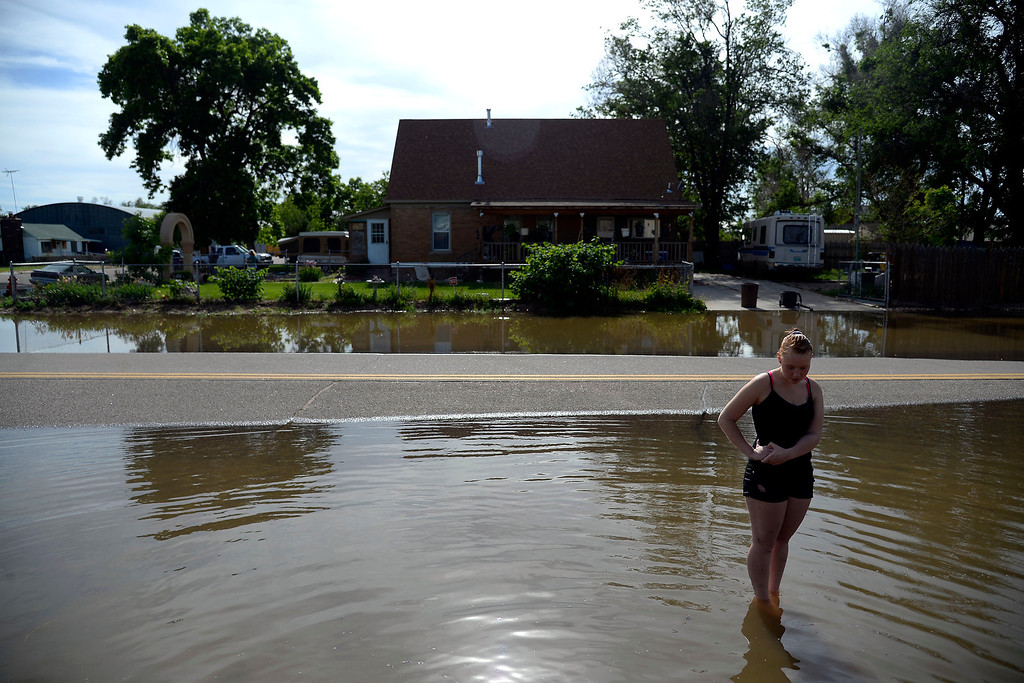 . Jessica Thompson, 16, stands in the water after an area of town flooded near Fifth Avenue and Fifth Street. A heavy rain caused parts of Greeley to flood on Monday, June 2, 2014. (Photo by AAron Ontiveroz/The Denver Post)