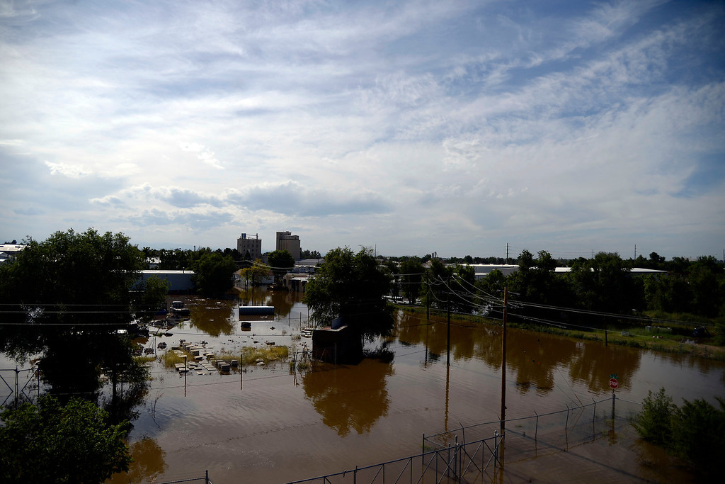 . An area of town as seen from a scissor lift at Thompson\'s Garage Door Service after an area of town flooded near Fourth Avenue. A heavy rain caused parts of Greeley to flood on Monday, June 2, 2014. (Photo by AAron Ontiveroz/The Denver Post)