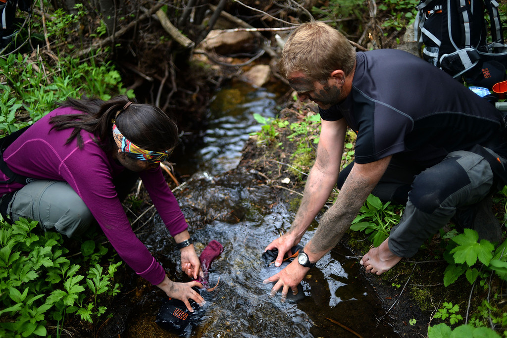 . WARD, CO - JUNE 10: Joanna Rivera filters water through her sock with instructor James Turner. Bear Grylls survival school at Glacier View Ranch near Ward, Colorado on Tuesday, June 10, 2014. (Photo by AAron Ontiveroz/The Denver Post)