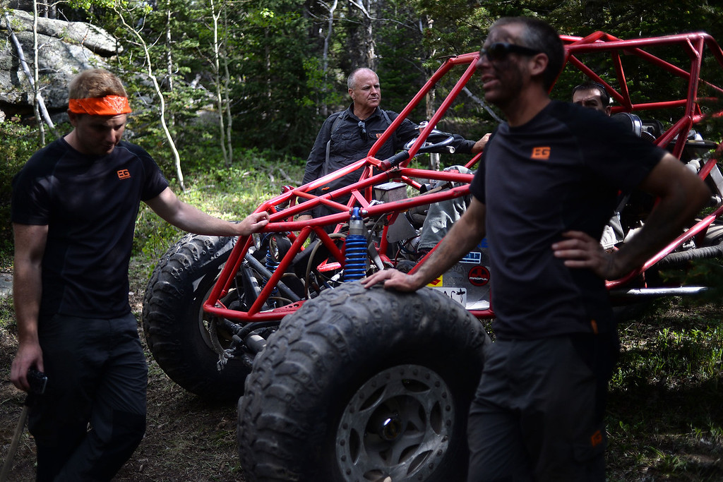 . WARD, CO - JUNE 10: Instructors from left, Don Fletcher, Alan Pratt and Jim Hughes take a breather next to a rock crawler. Bear Grylls survival school at Glacier View Ranch near Ward, Colorado on Tuesday, June 10, 2014. (Photo by AAron Ontiveroz/The Denver Post)