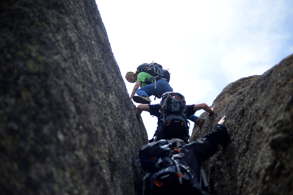 . WARD, CO - JUNE 10: Elizabeth Beem climbs a boulder with fellow students. Bear Grylls survival school at Glacier View Ranch near Ward, Colorado on Tuesday, June 10, 2014. (Photo by AAron Ontiveroz/The Denver Post)